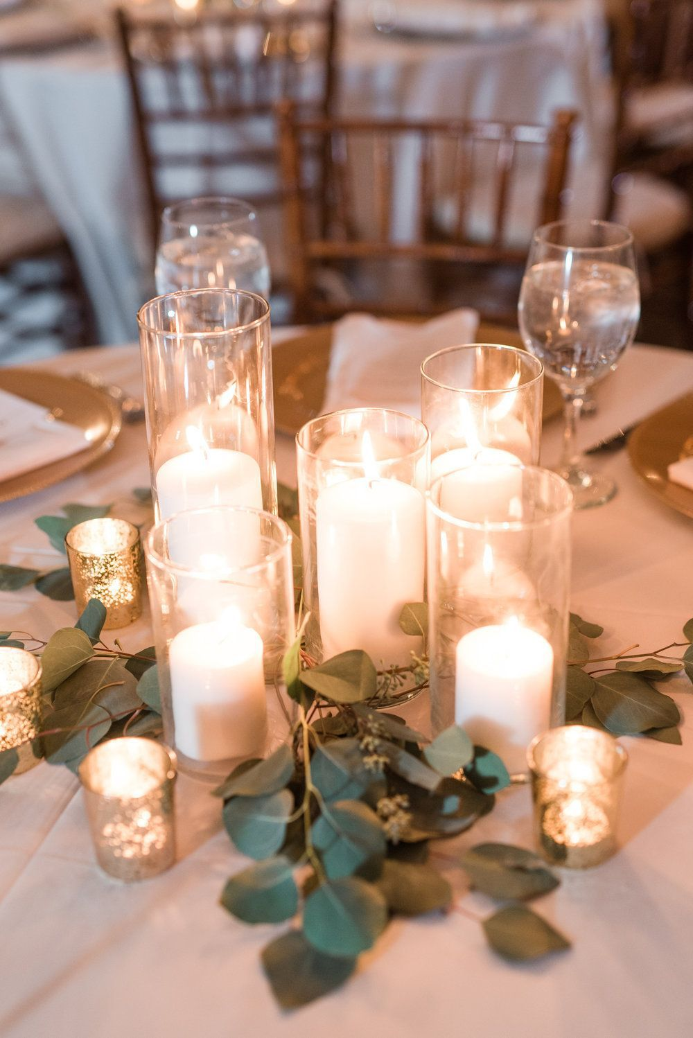 winter wedding centerpieces ideas with candles and greenery