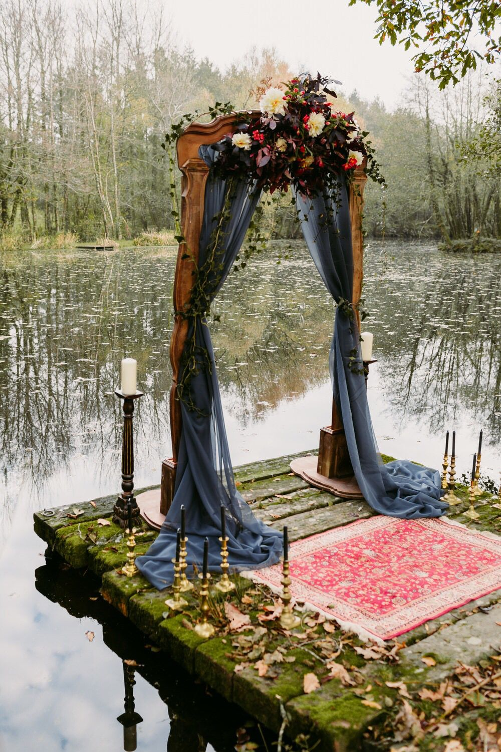 dreamy navy blue drapery vintage wedding ceremony ideas with candle sticks