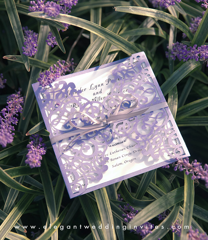 elegant lavender purple laser cut wedding invites with ribbons