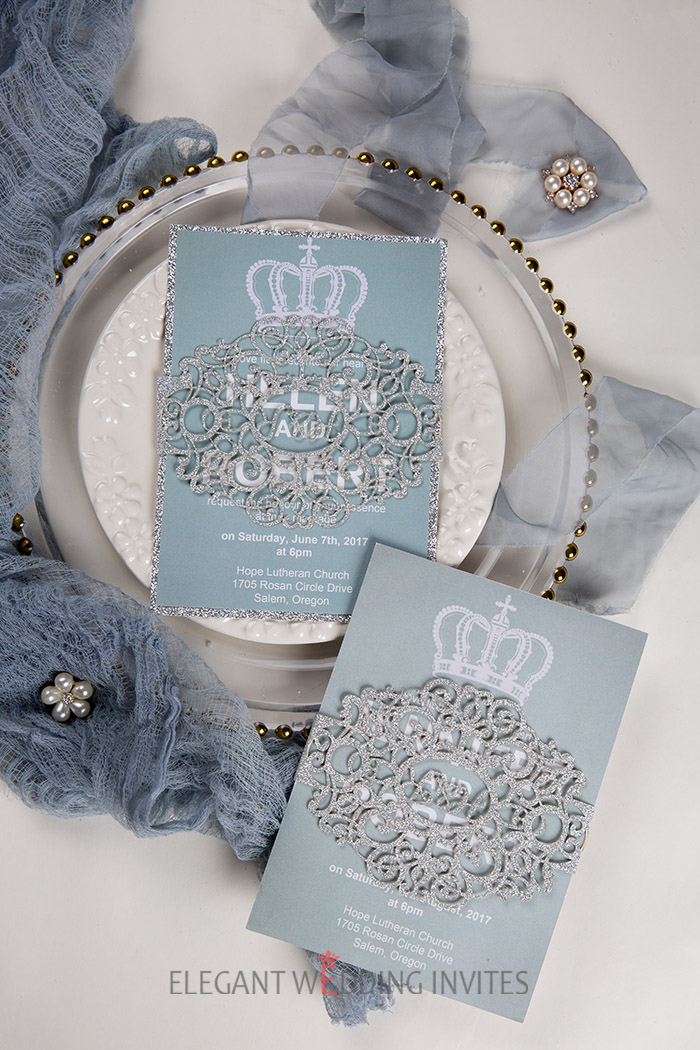 Dusty blue and silver glittery wedding invitations