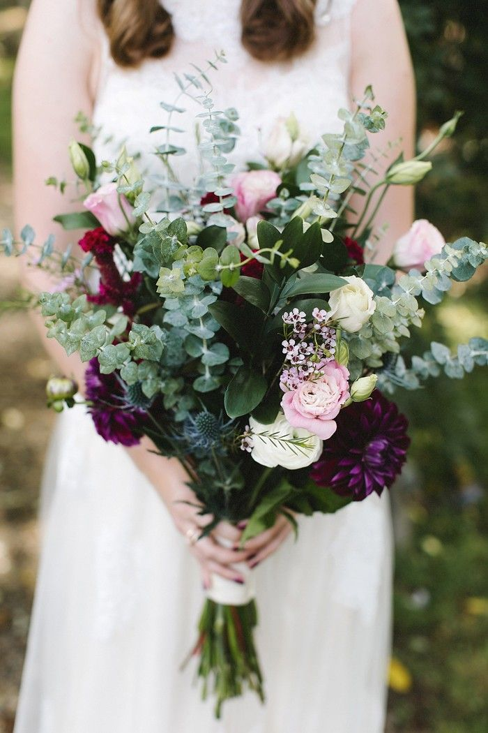 pink roses, purple zinnias, and sage green eucalyptus spring and summer moody wedding bouquets