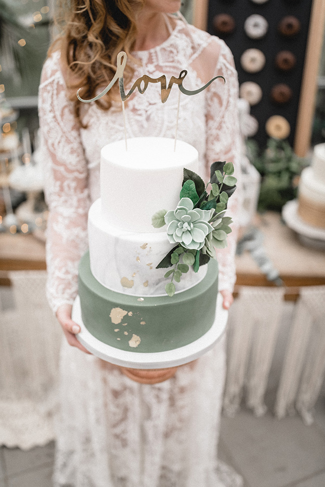romantic sage green and white wedding cakes with glitter accents