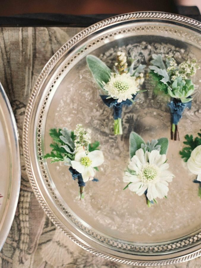 white and sage green botanical groom boutonnieres