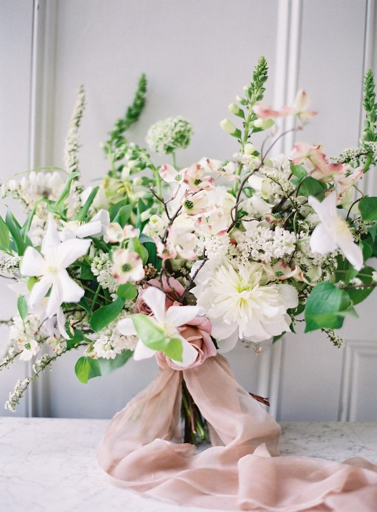 white greenery spring and summer bridal bouquet with romantic dusty rose ribbons