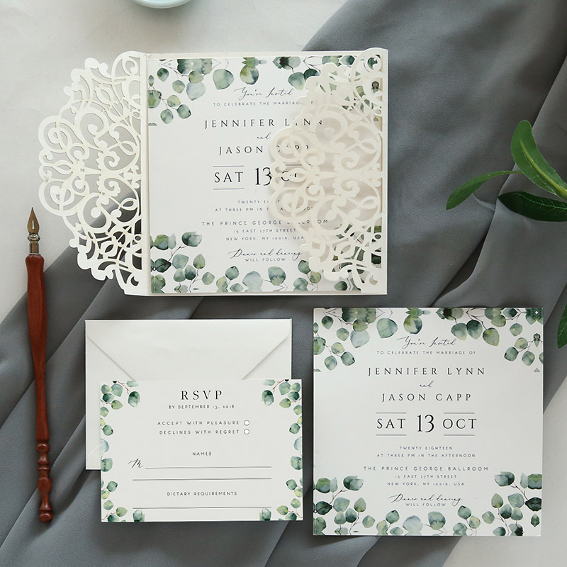 ivory laser cut wrap invitation with green botanical touches