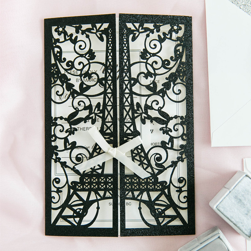 modern black glittery laser cut wrap with eiffel tower pattern and bow