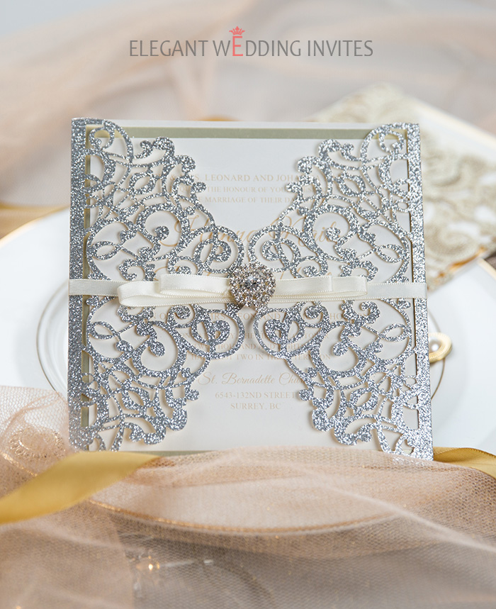 luxury silver glitter laser cut wedding invitation with champagne backer