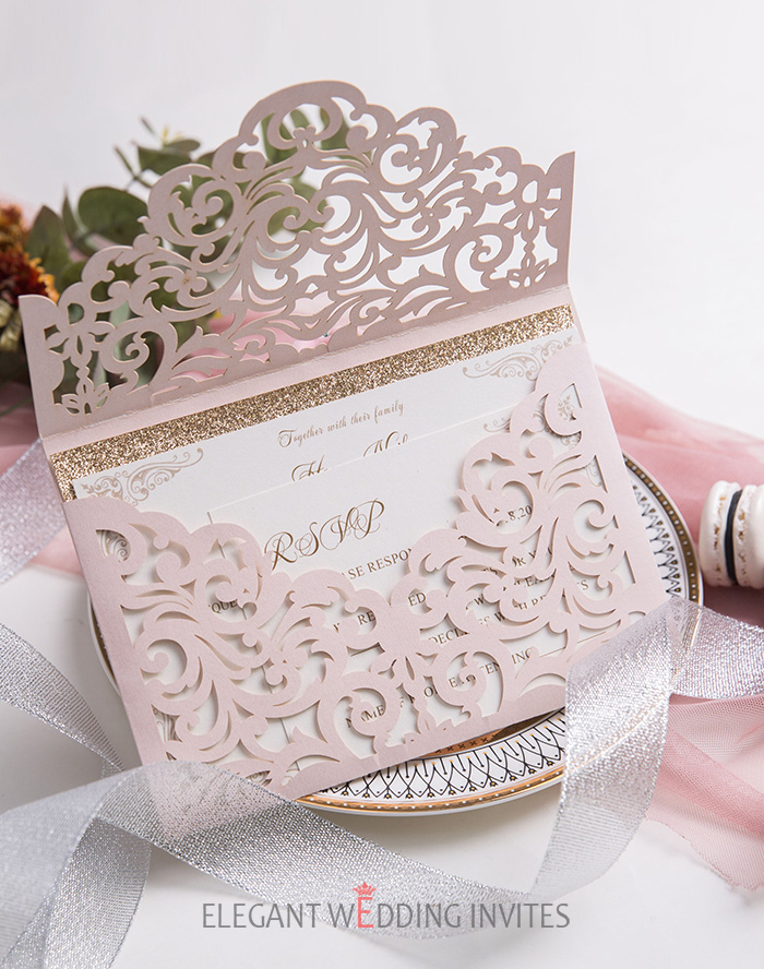 stylish blush laser cut wedding invitation with rose gold accents