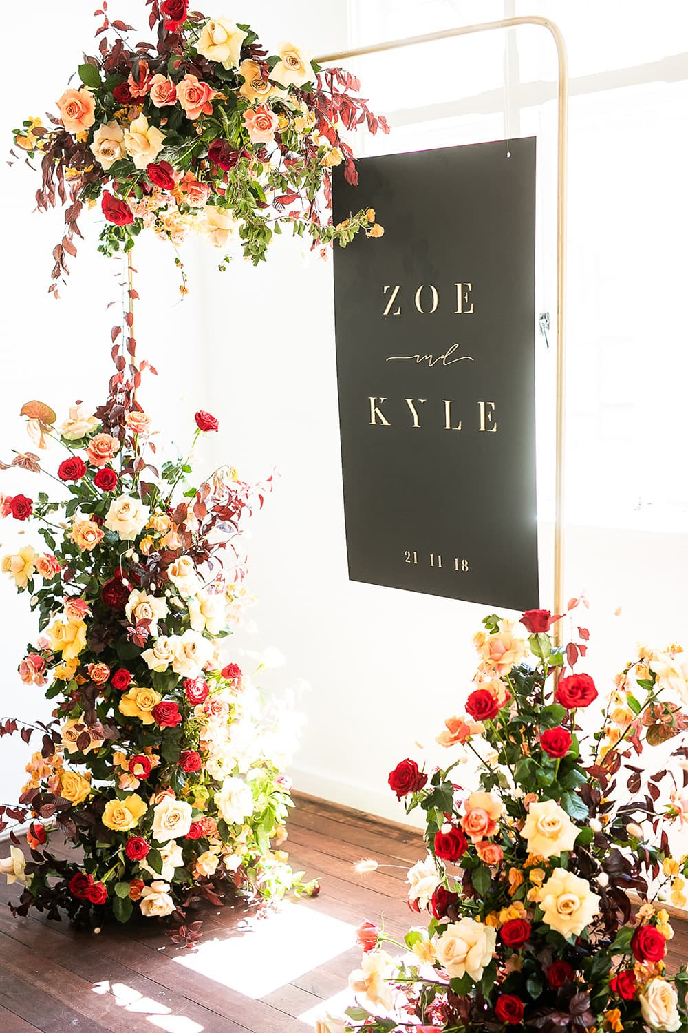 chic modern floral wedding arch ideas with black board acrylic sign