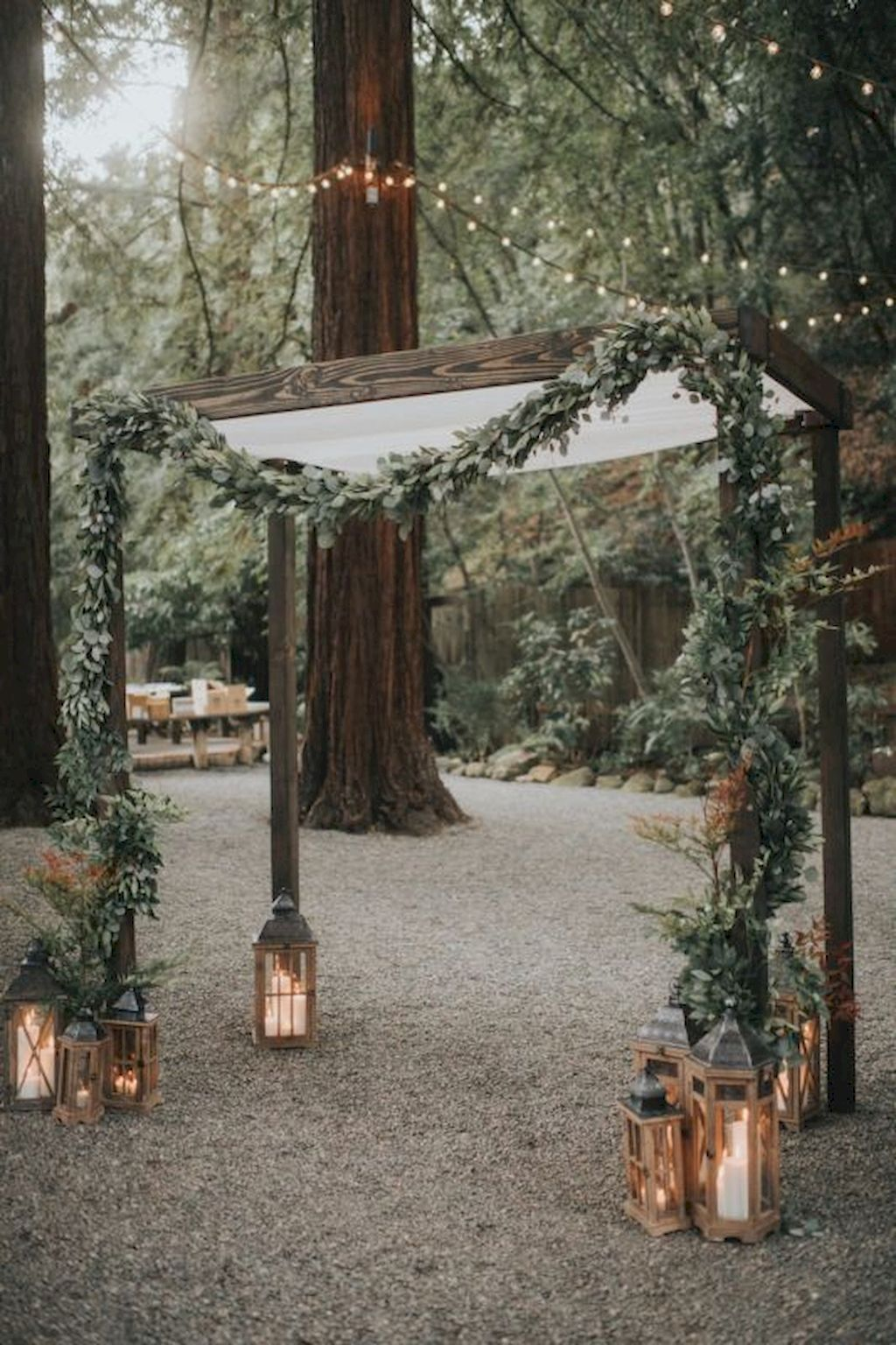 fall wedding arch ideas with greenery and lanterns