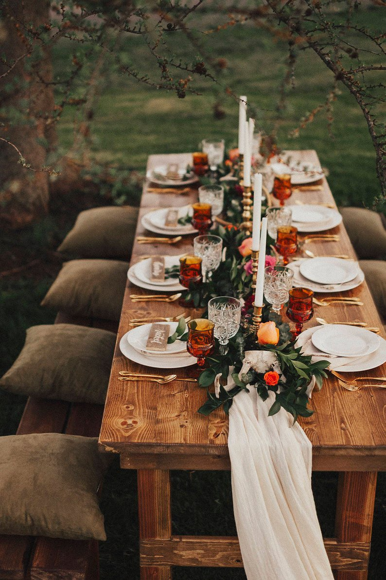 moody dark orange and brown fall boho style wedding table ideas