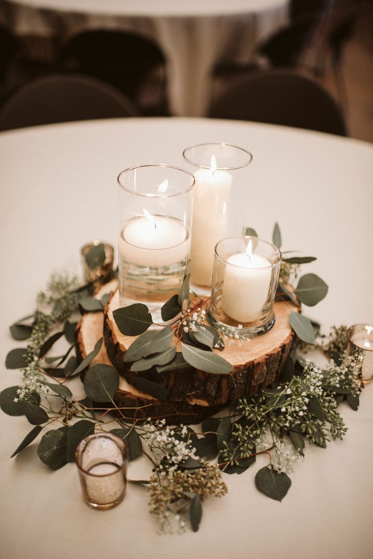rustic chic wedding table styling with white candles and eucalyptus