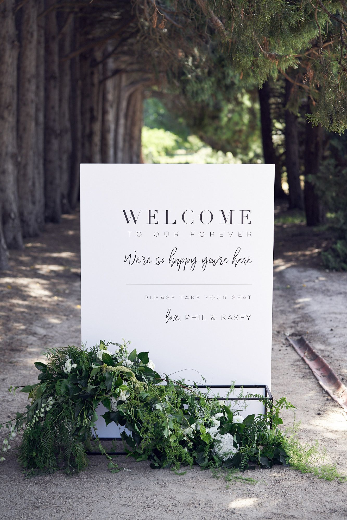simple white and greenery modern wedding sign board ideas