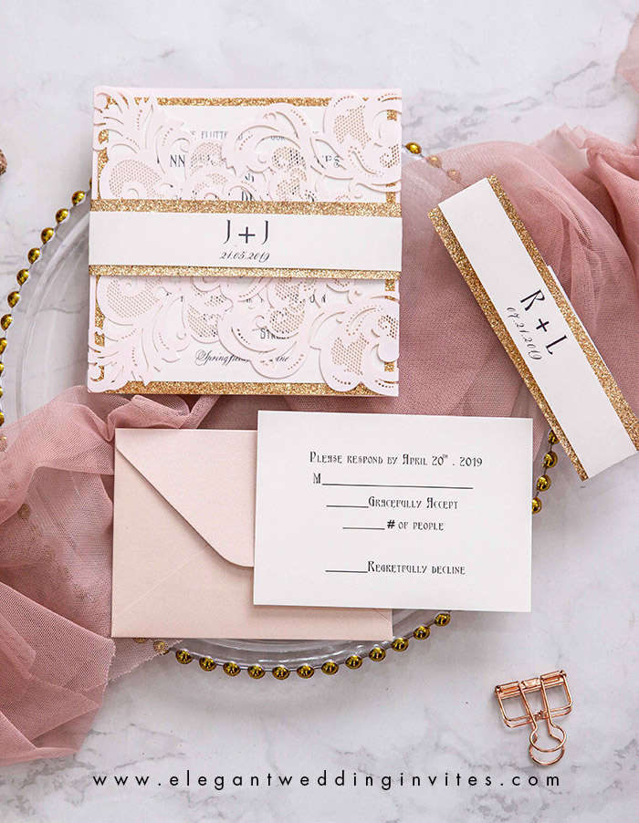 blush and rose gold belly band wedding invites