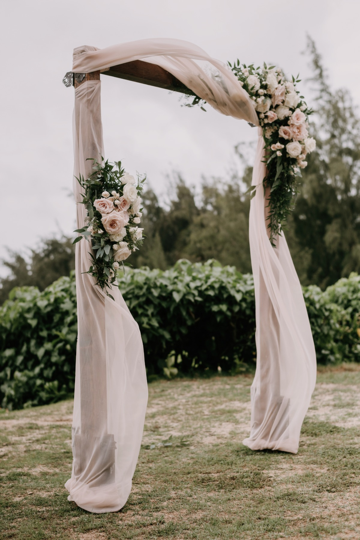 blush drapery outdoor wedding arch ideas