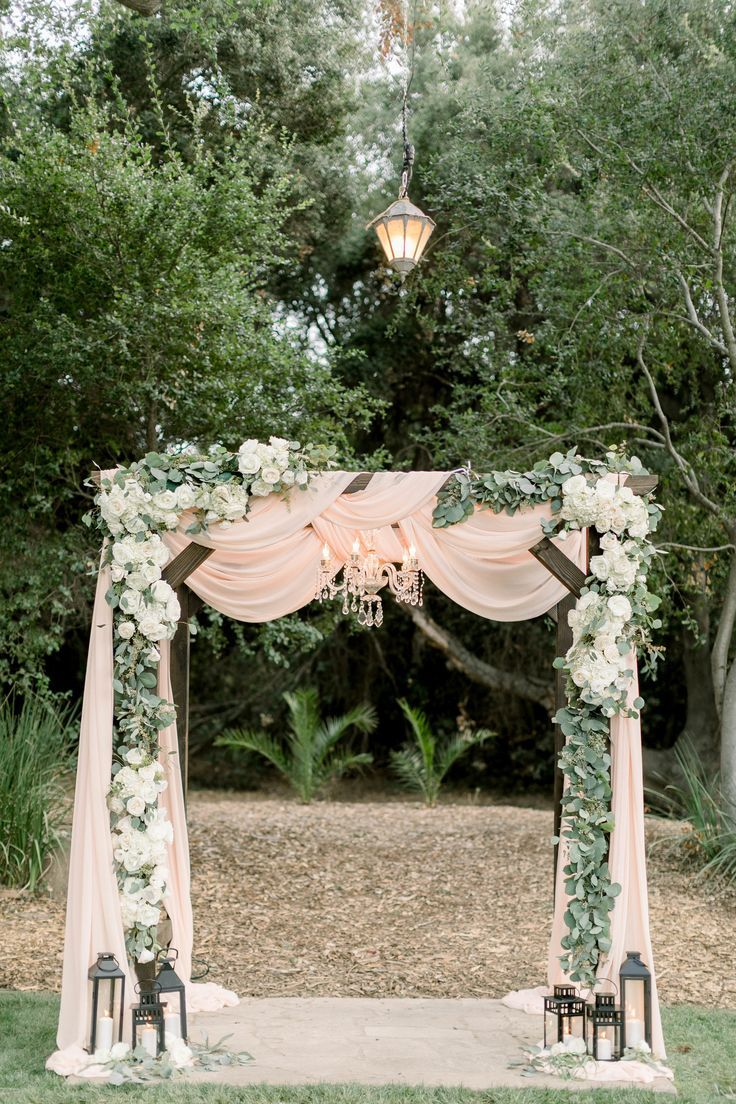blush pink drapery wedding arch ideas with lights