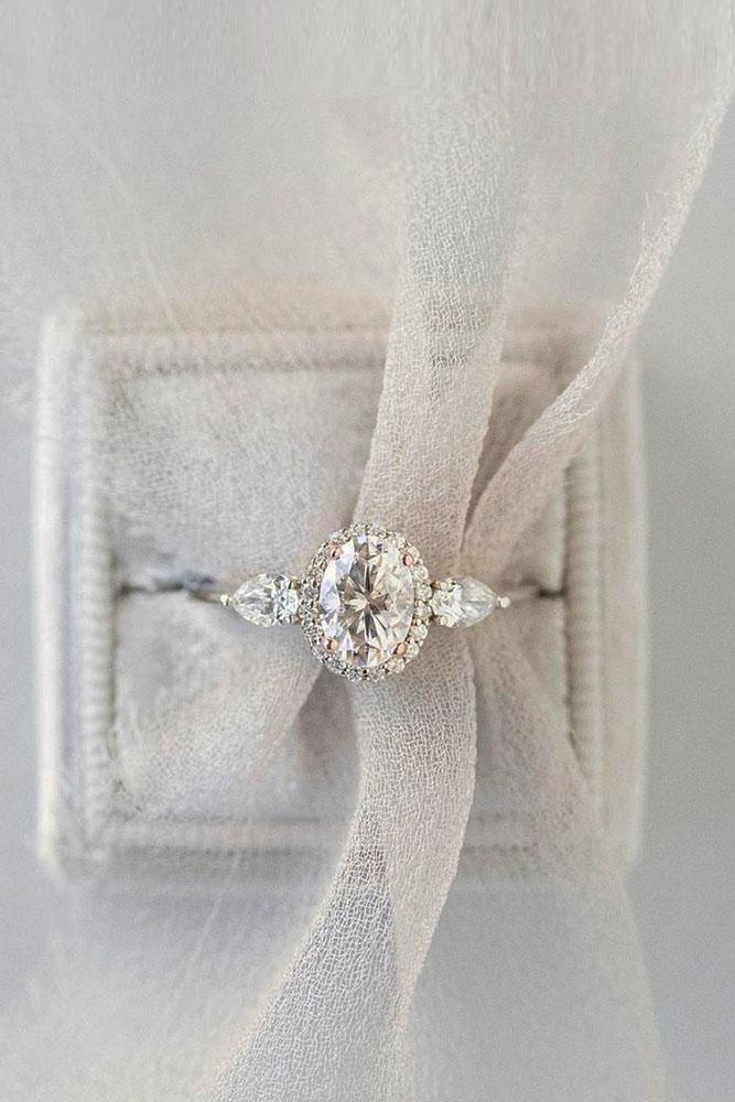 oval engagement ring in diamond halo