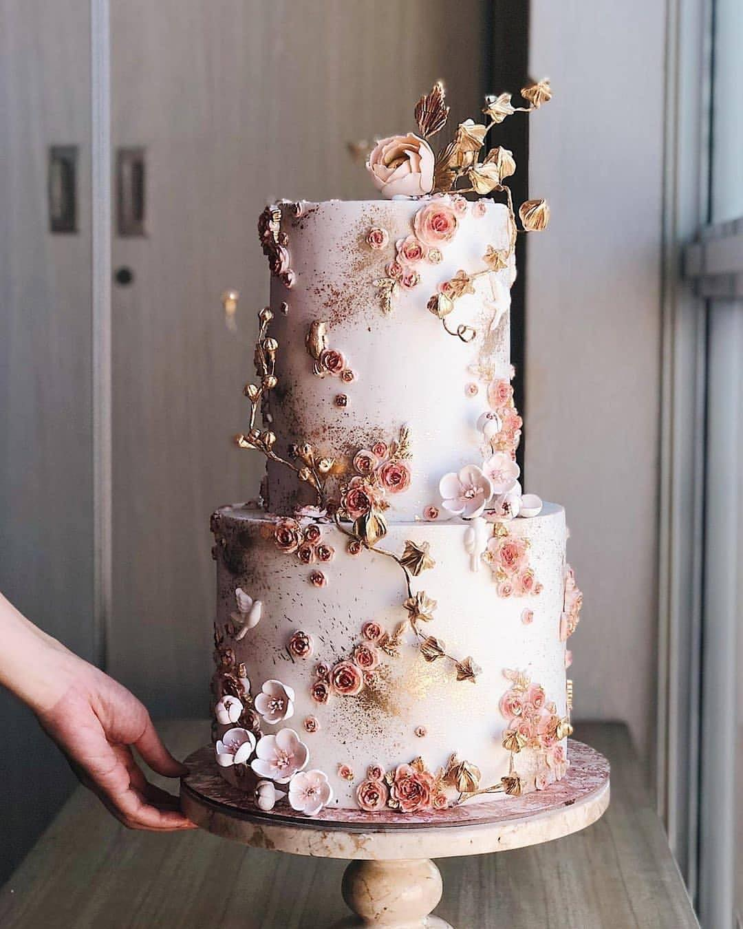 pretty and delicious blush floral wedding cakes with glitter gold accents