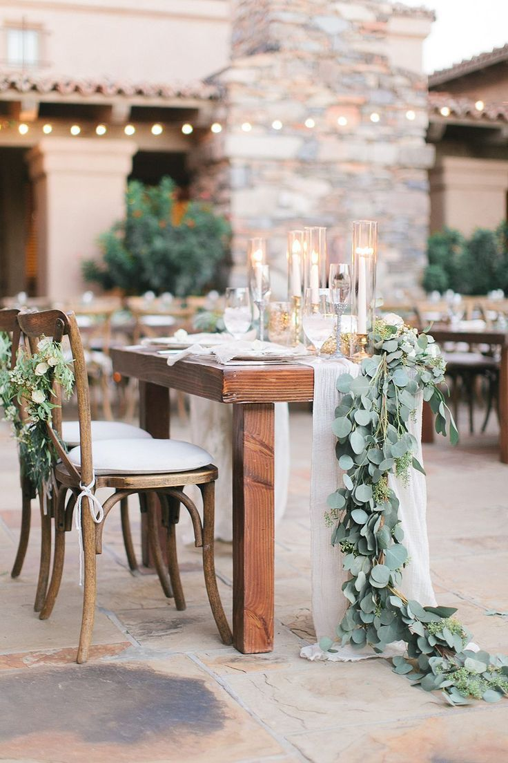 greenery garland bride and groom wedding table ideas with candle lights