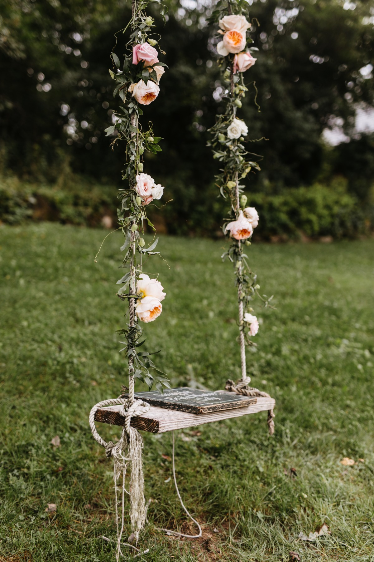 pretty foral decorated swing for garden weddding idea