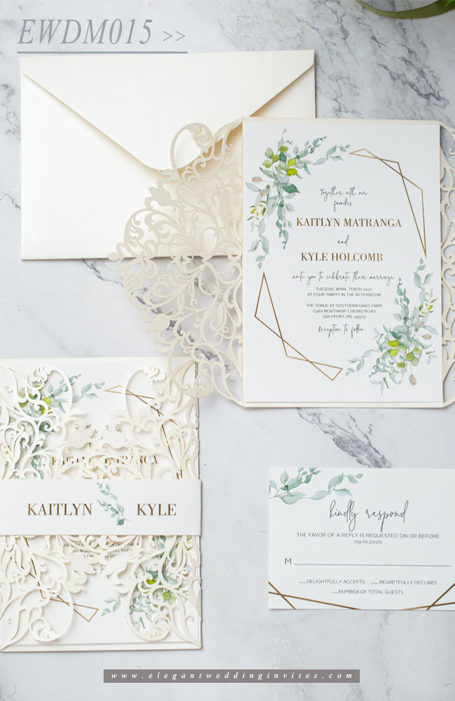 elegant ivory laser cut wedding invitation with greenery pattern around framed wording