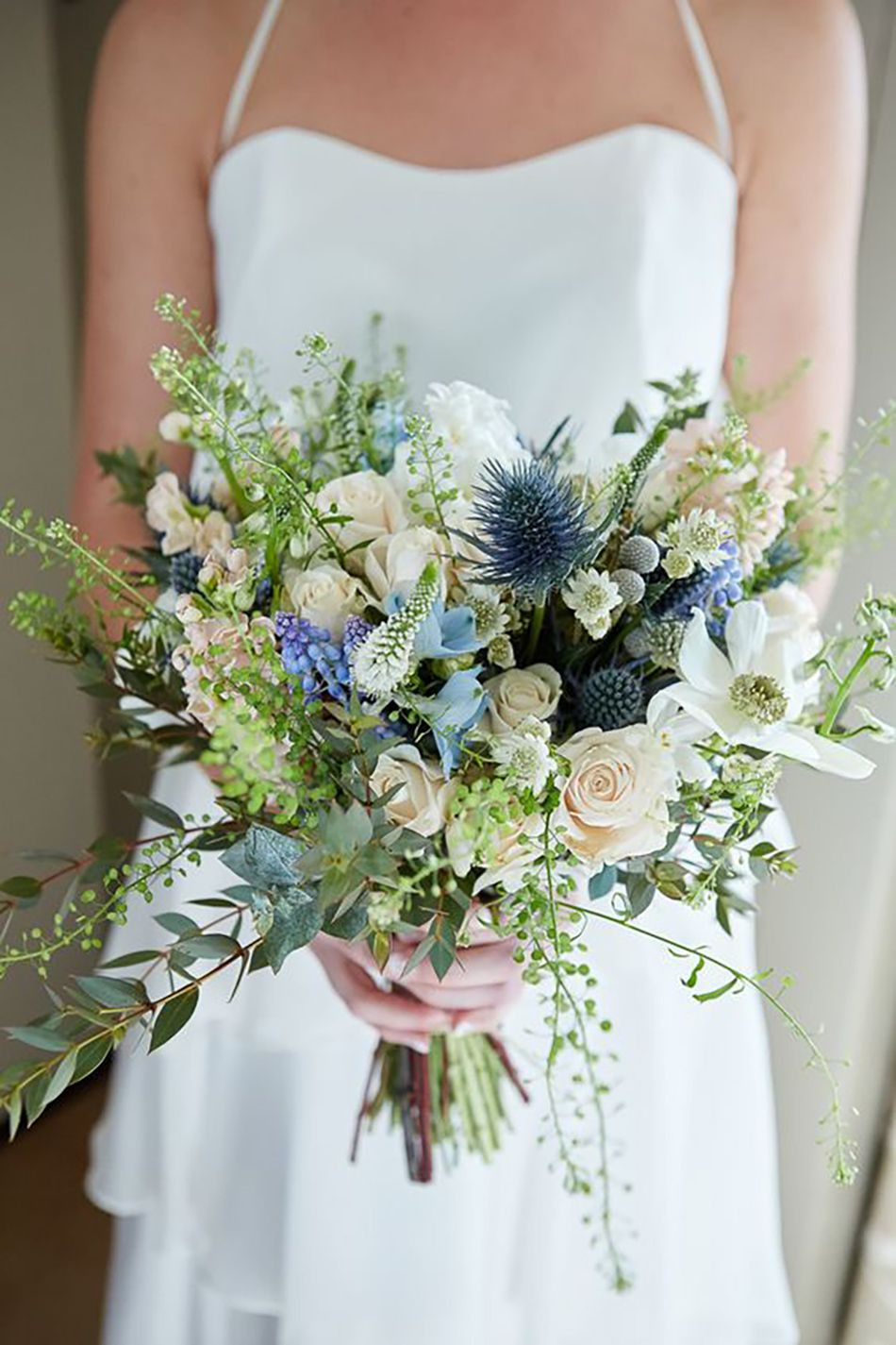 blue and ivory white bridal flower bouquets