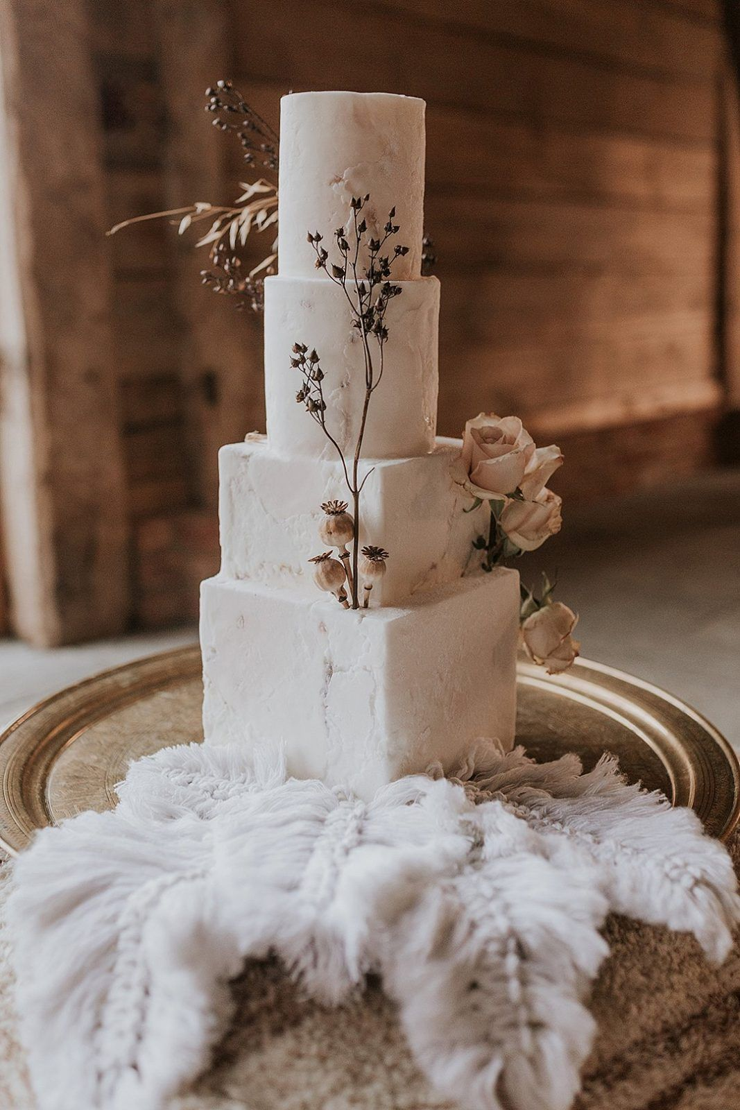 elegant unique marble-inspred wedding cakes in different shapes