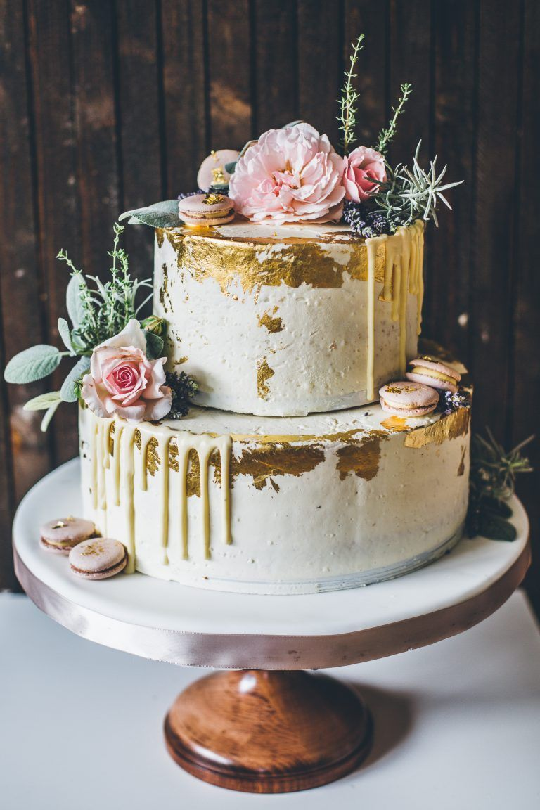 gold foil and drip wedding cake with flowers