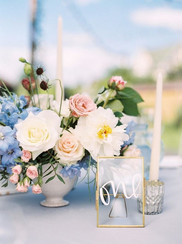 light blue and blush pink wedding centerpiece and table number