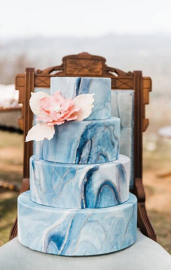 marble blue wedding cake with pink flowers