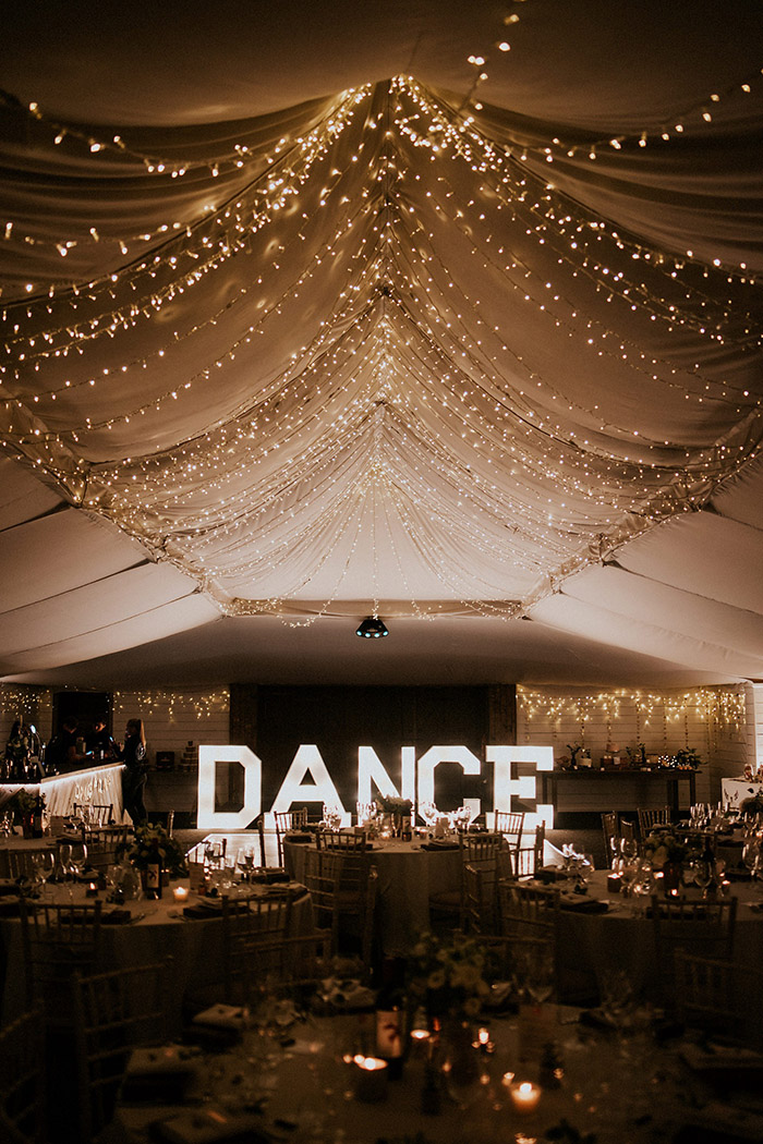 modern wedding reception wth fairy lights and dance light up letters