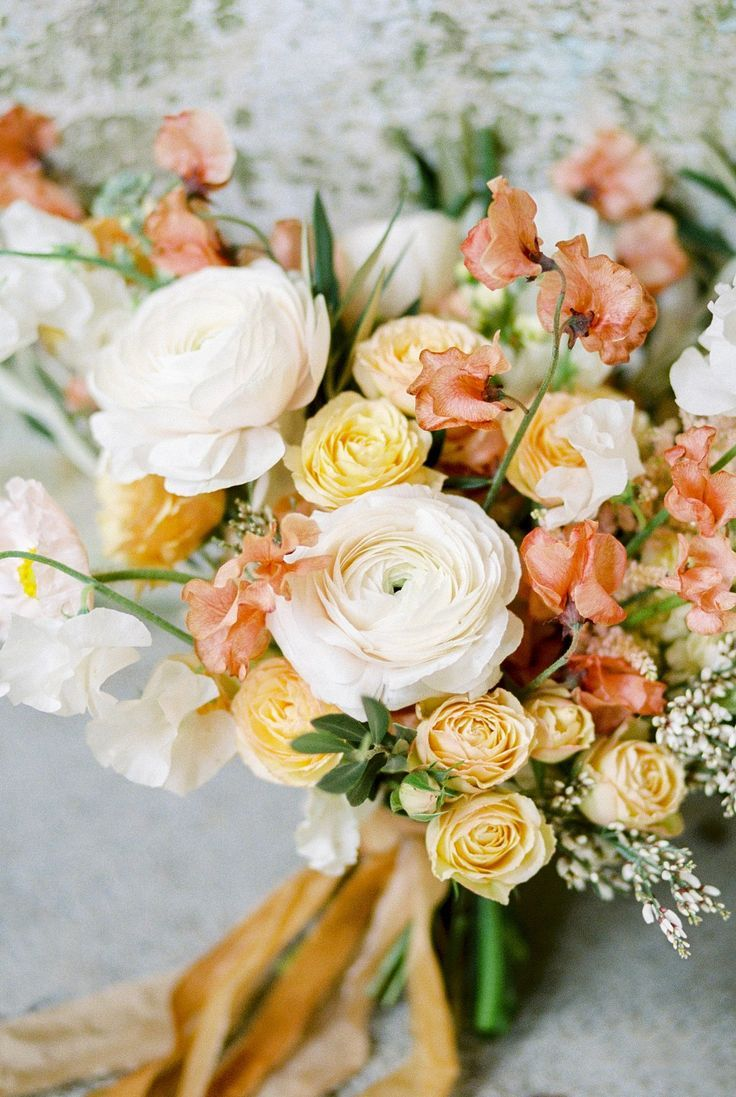 peach and pale yellow bridal bouquets