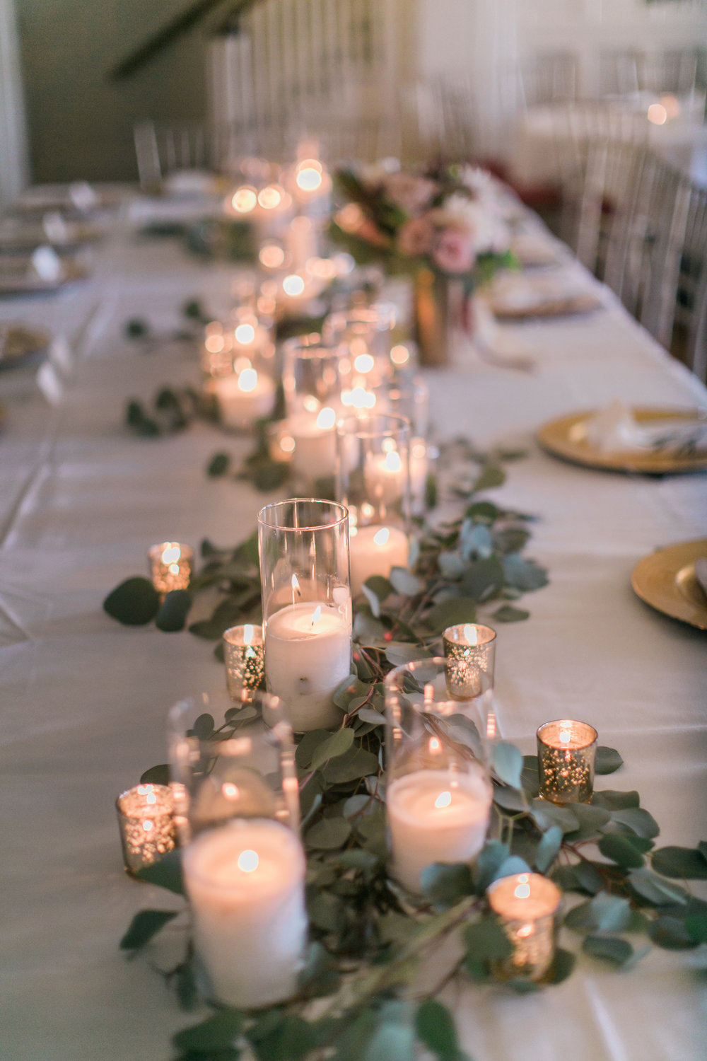 romantic greenery garland wedding table setting with candle light