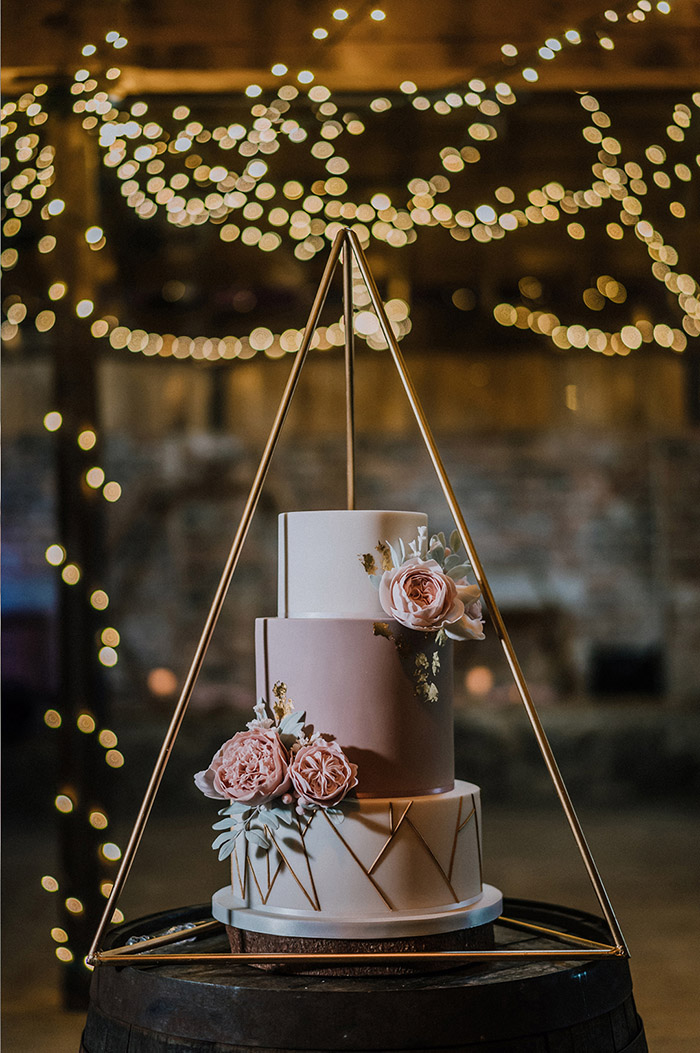 simple 3 tier wedding cake with golden geometric details