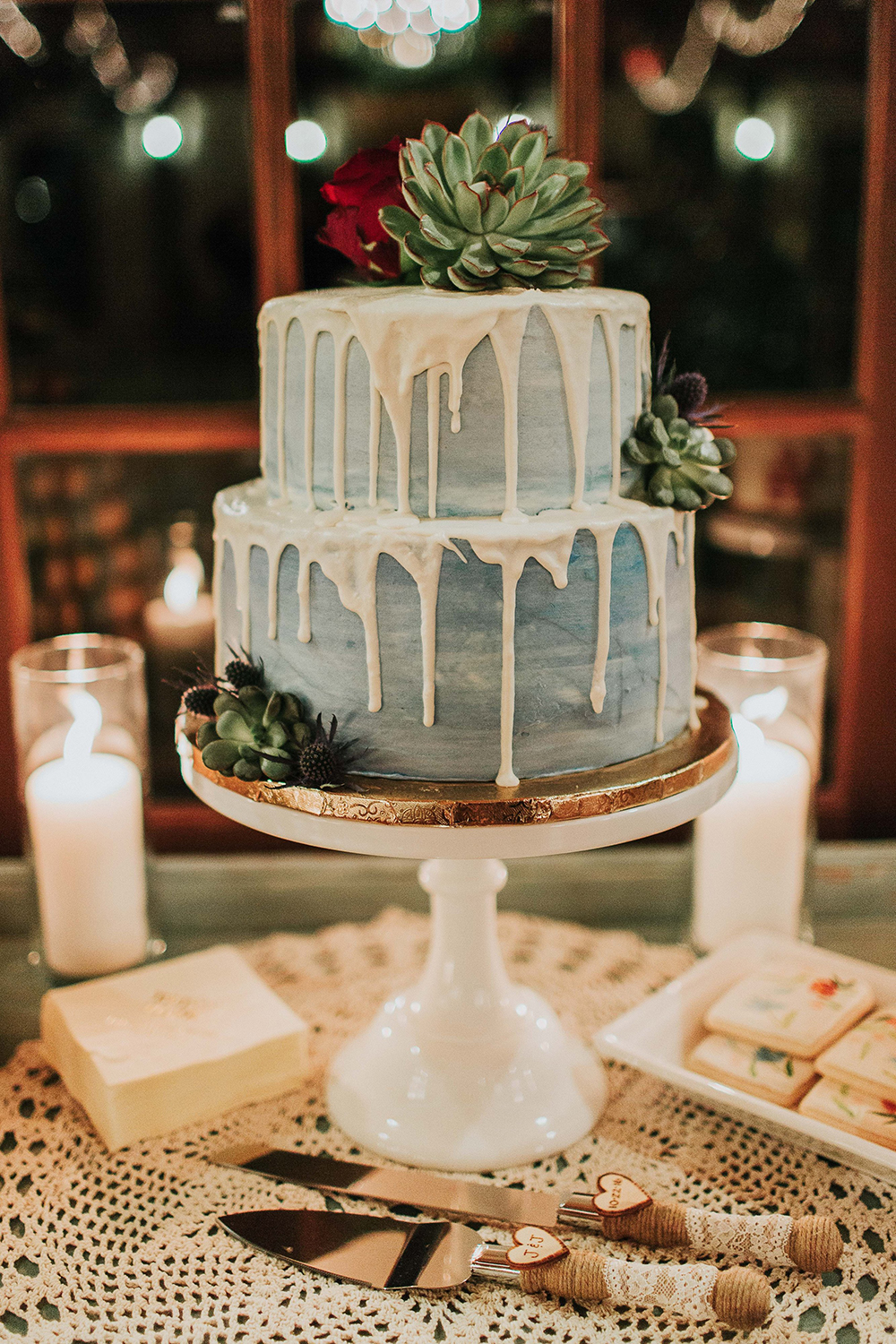 simple sage green drip wedding cakes with succulent