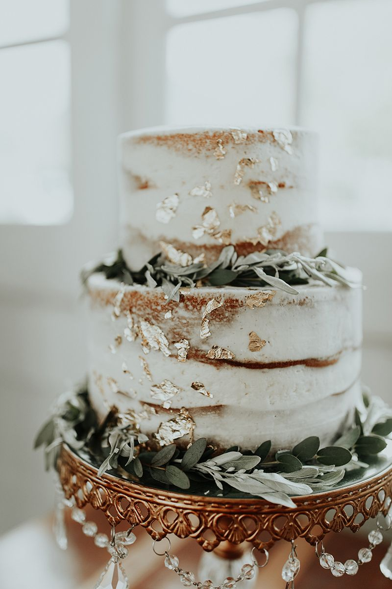 simple silver sage green naked wedding cakes with foil gold details
