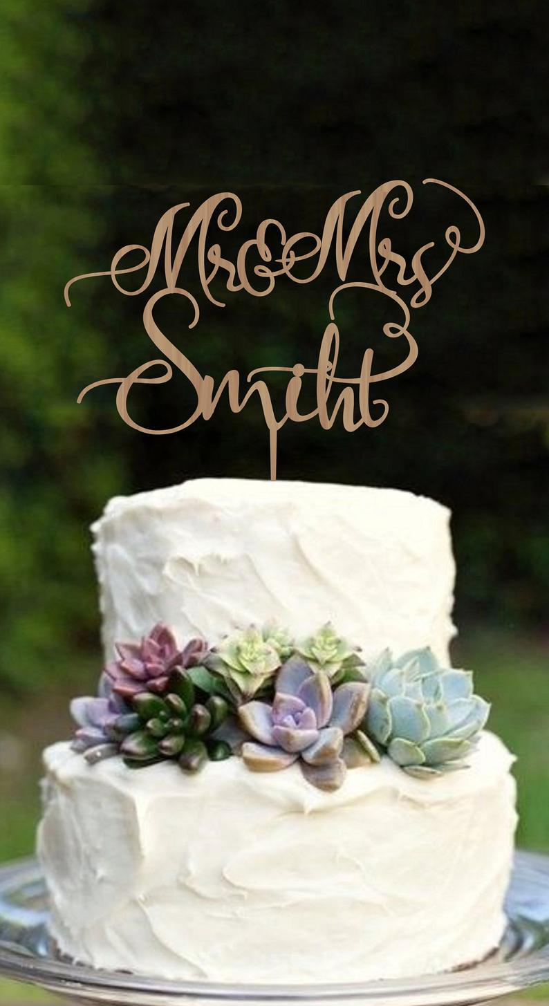 simple two tier wedding cake with cake toppers