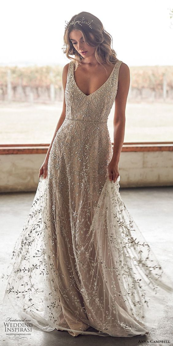 sleeveless beaded deep v neckline fully embellished wedding gown