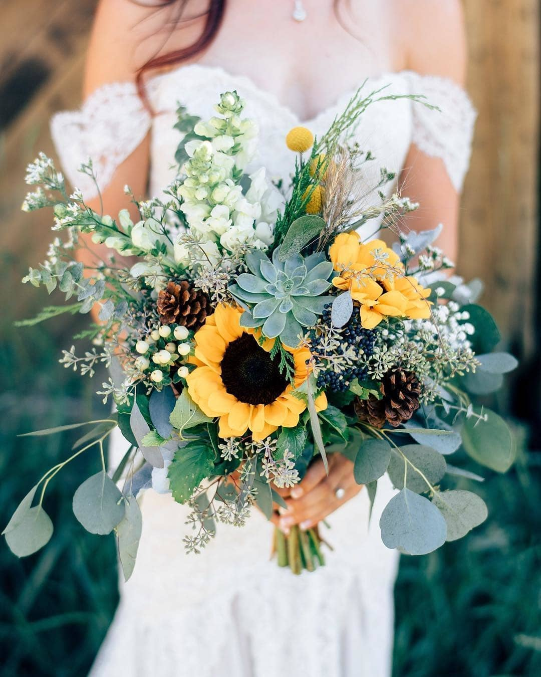succulent and sunflower wedding bouquets