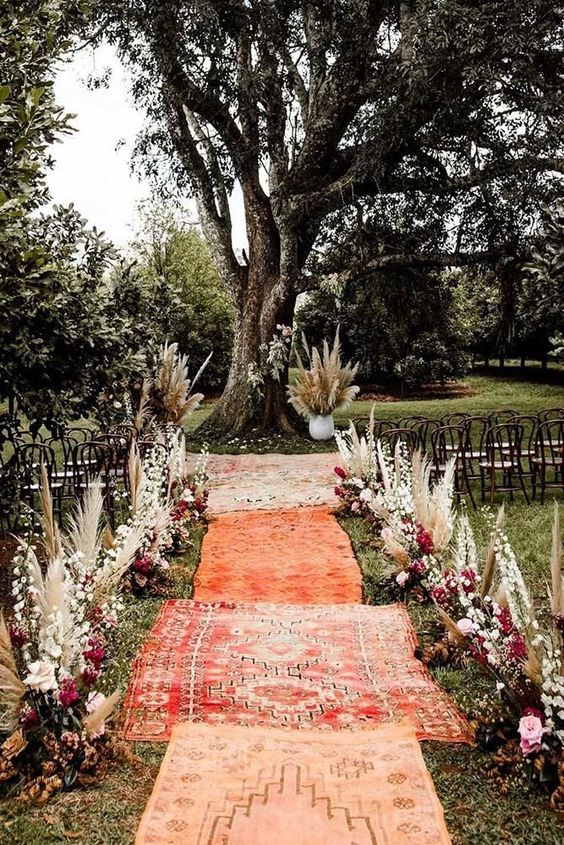 Boho wedding aisle runner with dried flowers and pampas grass for fall wedding
