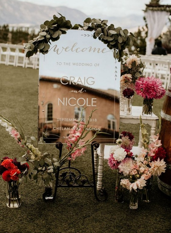 Chic outdoor mirror wedding signs with floral decorations