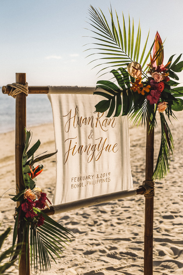 Fabric wedding signs with tropical florals for boho beach wedding theme