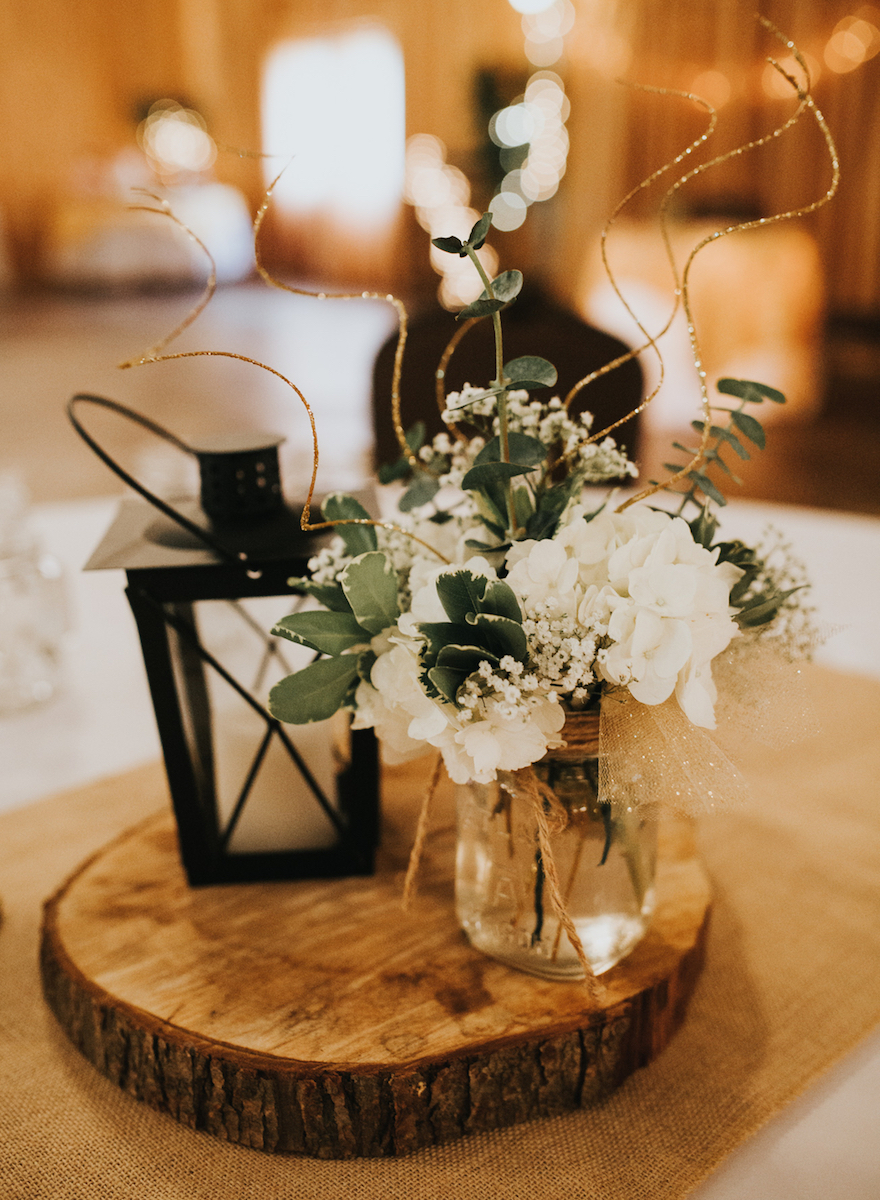 Unique lantern and mason jar with white folowers wedding centerpieces for october wedding