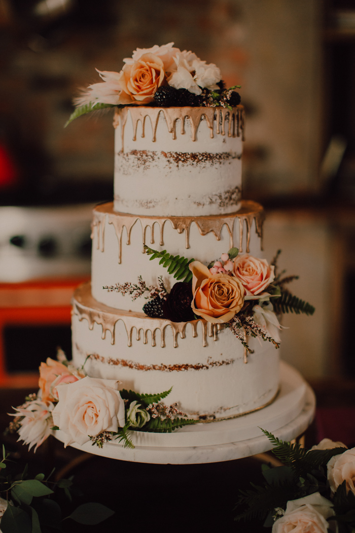 Vintage wedding cakes with gold foil and pink flowers decorations for October rustic wedding theme