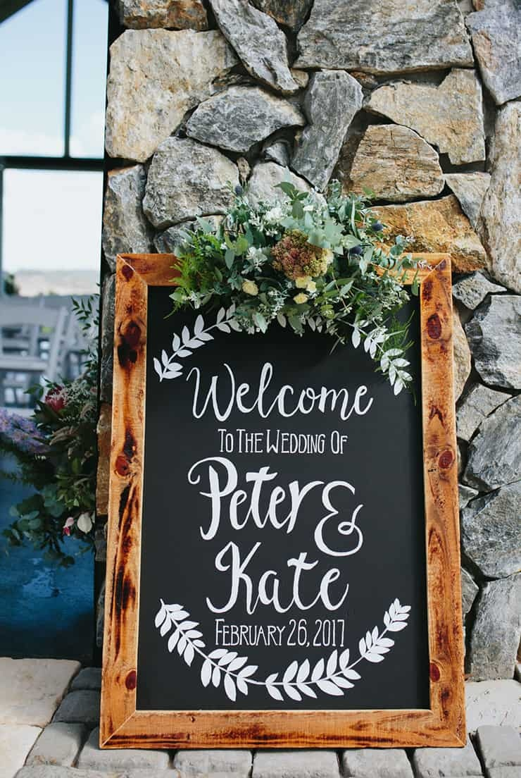 Wedding chalkboard signs with greenery perfect for garden wedding theme