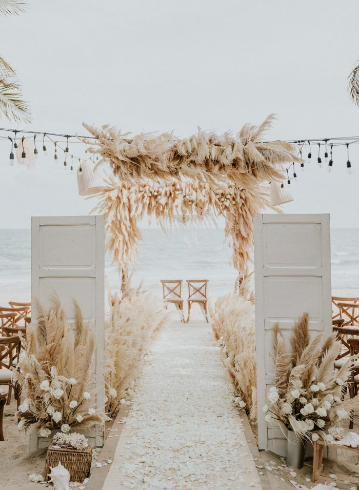 boho chic beach wedding ceremony ideas with doors and pampas grass