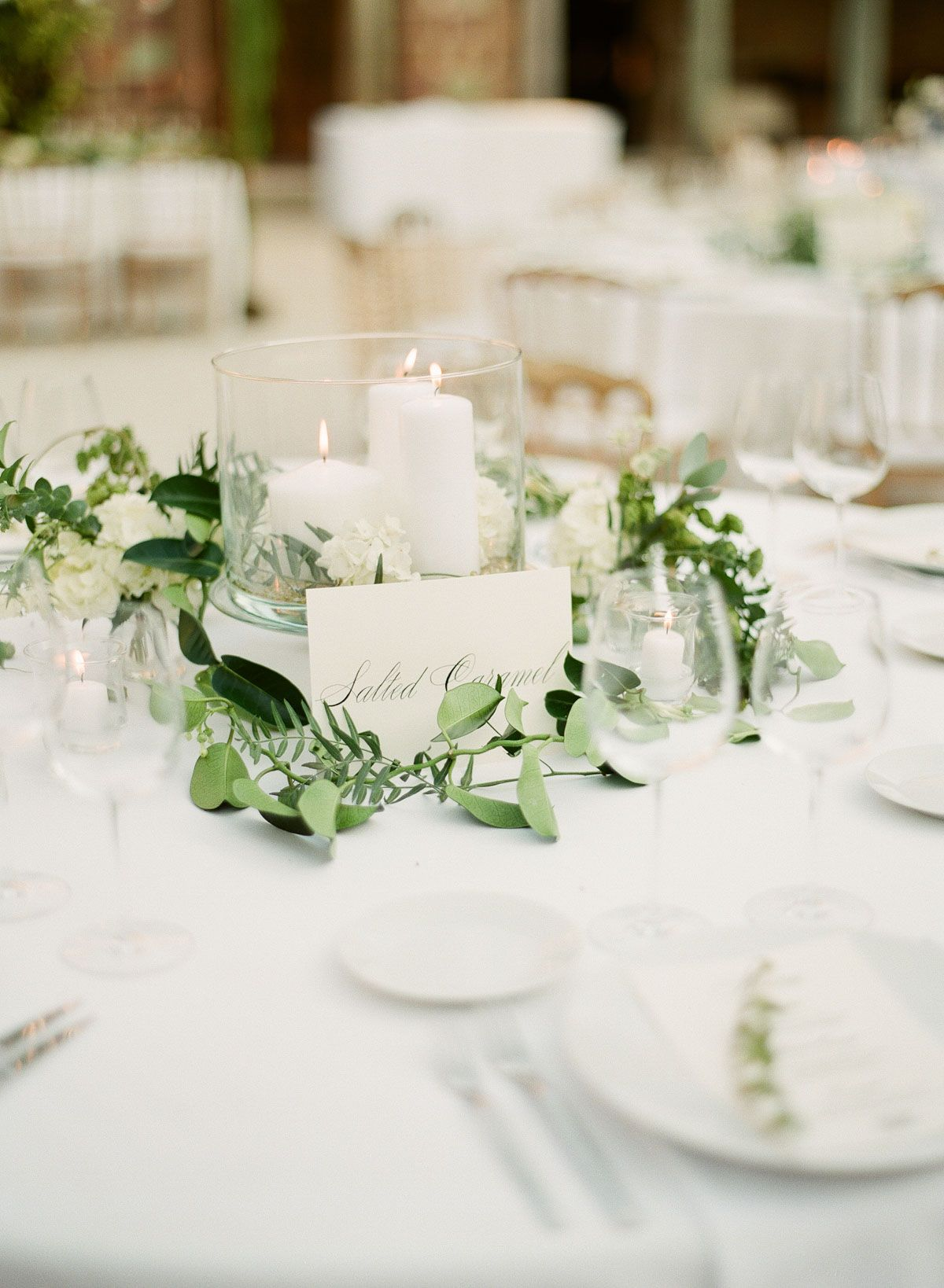 budget friendly DIY greenery wedding centerpieces with candle lights