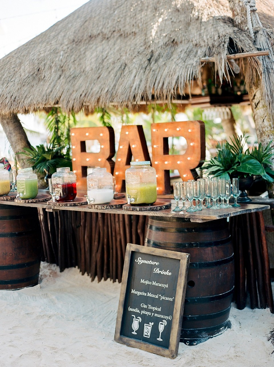 creative beach wedding drink bar ideas with light up letter signs