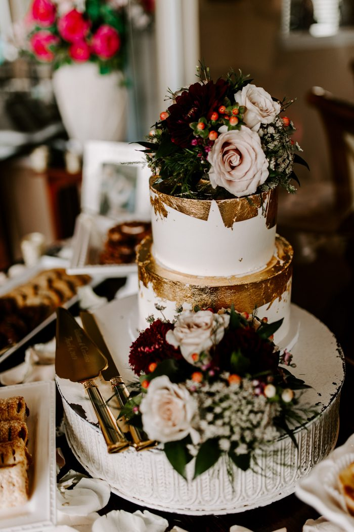 fall backyard flower wedding cake with gold foil