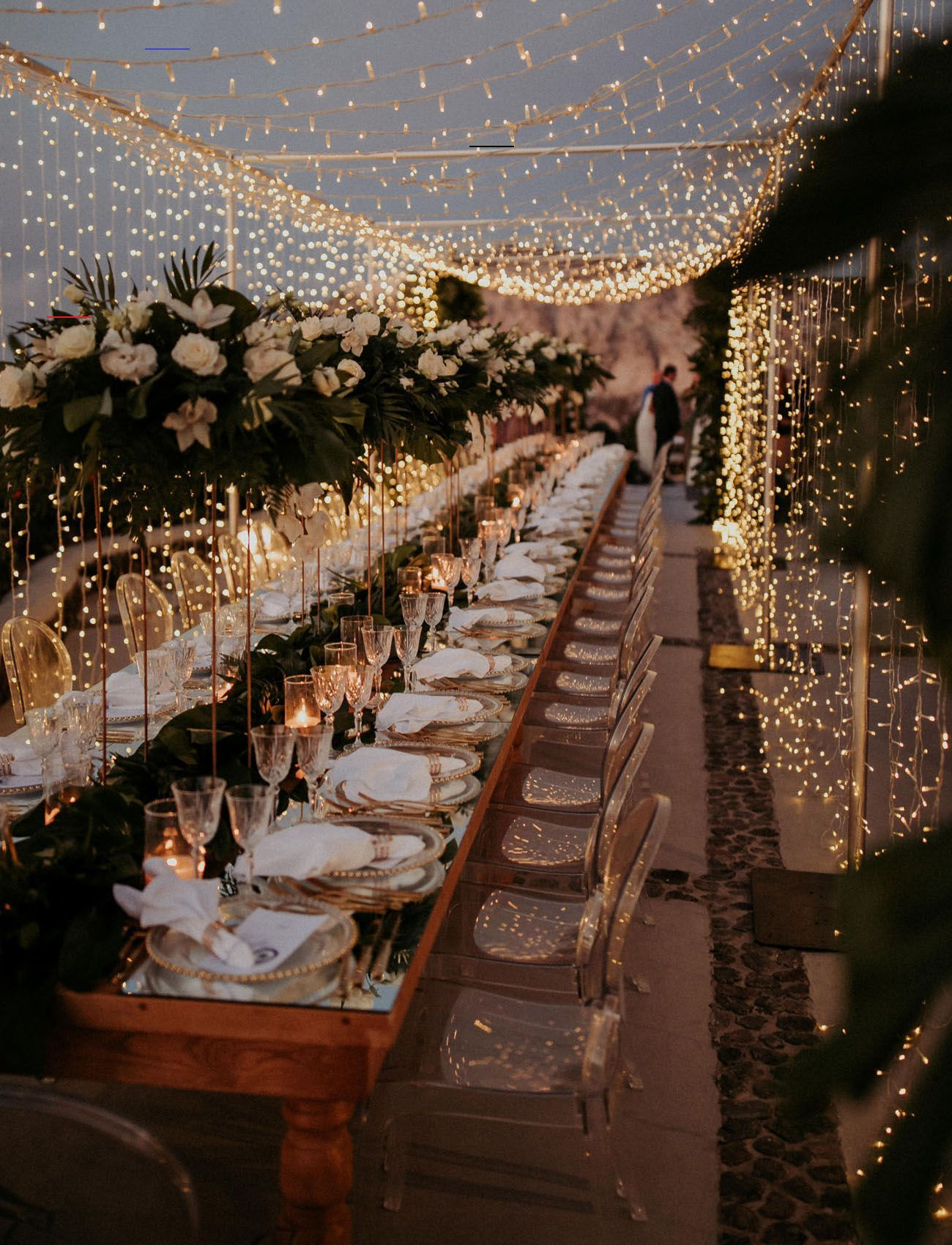 magical wedding reception decor with fairy lights and acrylic chairs